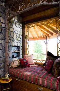 rustic reading nook, Adirondack style. I could read here all day long.....ahhhhhhh
