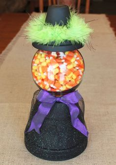 DIY Halloween Candy Jars made to look like a witch from terracotta pots and a glass bowl.