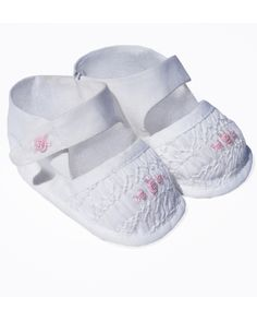 This is an adorable pair of girls infant christening shoes made in cotton fabric…