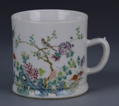 China, 19th C., Famille Rose tea mug, with colorfully painted birds and floral elements on a glossy white ground, with Xian Feng mark on base. Height 3 3/4 in.