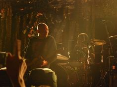the smashing pumpkins during their last show in paris, nov. 2011 at le zenith. corgan demonstrates he's the one without whom the bend couldn't be called smashing pumpkins anymore!
