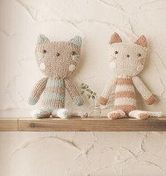 Cats! I would love to knit this is a comfy yarn, just imagine all the loves it would get ;)