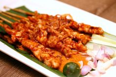 sate ayam madura ( chicken, peanut sauce, a sprinkling of fried onions )