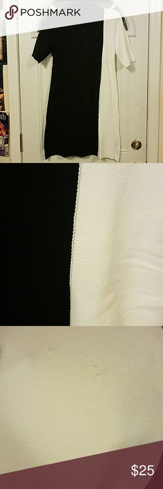 ZARA Black & white knit dress Medium weight 100% polyamide dress. Does have stretch, must pull over as there is no zipper. Slight flaw found at bottom right/white area, barely noticible. See 2nd to last pic, best way I can describe is it looks like minor snagging. Length measured from shoulder to hem is about 34 in, accross measured from under arms is about 16 inches. Nice dress for cooler days, would look great with some boots.zar Zara Dresses Midi