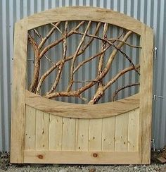 Nature Inspired Garden Gate Made From Tree Branches And Pallets