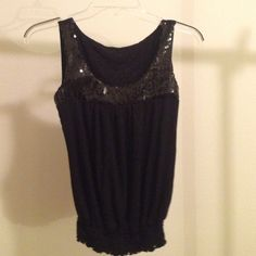 BLACK SEQUIN TOP SIZE SMALL NWOT. Fits XS to small juniors. I changed my mind about it. Paid $27 for it. Make me an offer! Tap on my user name to see everything in my closet. I discount bundles as well! 🎁👛🎀 Tops