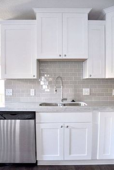 An example of gray subway tile in a white kitchen with white grout. Smoke Gray glass subway tile, white shaker cabinets, pull down faucet - gorgeous contemporary kitchen. Home Kitchens, Contemporary Kitchen, Kitchen Remodel, Kitchen Design, New Kitchen, White Kitchen Cabinets, Kitchen Cabinets Decor, Kitchen Styling, Shaker Cabinets