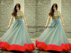 Pastel blue kong gown with contrast red border and a gol embroidered leaf on the yoke, designed by Anitha Reddy.