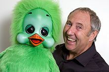 "Keith Shenton Harris (21 September 1947 – 28 April 2015) was an English ventriloquist, best known for his television show The Keith Harris Show (1982–90), audio recordings, and club appearances with his puppets Orville the Duck and Cuddles the Monkey. He had a UK Top 10 hit single in 1982 with ""Orville's Song"" which reached number 4 in the charts."