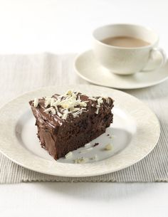 Mary Berry's Heavenly Chocolate Cake Recipe // Two layers of chocolate cake, sandwiched together with decadent fudge frosting. Finish with white chocolate curls for garnish!