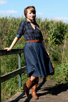 Western influenced 50s style outfit with cowboy boots and denim swing skirt