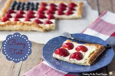 Very Berry Tart strawberries blueberries www.cookingonthefrontburners.com