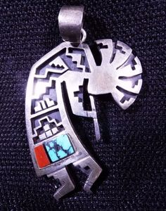 SoVintageous is offering this fabulous, extremely rare, sterling silver, turquoise, red coral and jet Navajo Kokopelli overlay pendant, handmade by the late Richard Begay (1943 - 2013).  Traditionally