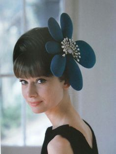 Audrey Hepburn photographed in the 1960s by Howell Conant wearing a gorgeous flower shaped hat.