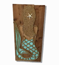 Original, one of a kind, rustic wall art featuring rustic wood, rope and paint shaped into a beautiful mermaid. Signed by the artist and ready to hang on in your covered porch or lanai. Free shipping
