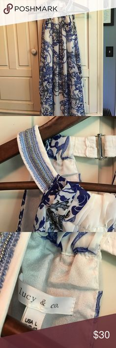 NWOT trendy summery dress!!☀️☀️👍❤️ White with blue flowery print! Neck closure with beaded detail and pockets!! Size listed is large, but runs small! I bought at a boutique on vacation and didn't try on! Runs very small! This would fit a medium! My loss is your gain!! ❤️❤️❤️❤️❤️❤️ Dresses