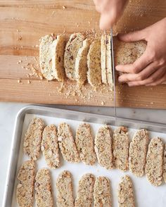 How to Make Classic Biscotti - Using a serrated knife with a sawing motion, cut logs into slices slightly thicker than 1/4 inch. Arrange, cut-side up, on parchment-lined baking sheets. Bake until dry to touch, about 30 minutes. Let cool completely on pans on racks, 30 minutes. Store in an airtight container up to 1 month.