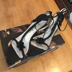 "Nicole Miller Couture Strappy Heels Size 10 These are beautiful Nicole Miller Couture black heels in size 10. The strap around the front has a patent leather flower and finished with straps around the ankles. These is a buckle closure around the ankle too. The heels are still in great shape at 3"" and they go from black to silver along the back. Fun & sexy for a night out! Nicole Miller Shoes Heels"