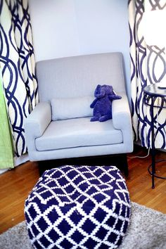 Navy and white nursery - love this @nurseryworks rocker paired with an ottoman pouf from @Target! #nursery