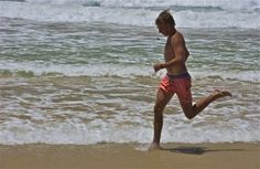In full stride; Bondi Beach; the people, the water, the town; New South Wales, Australia.  January 2014.