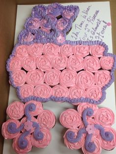 Pink and lavender baby carriage cupcake cake