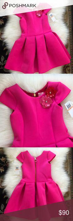 "Zoe LTD Pink Neoprene Girls Dress Size 7 NWT Zoe LTD pink girl dress.  Size 7.  Neoprene Fabric.  Hot pink dress.  Flowers attached.  NWT.  Pleated Skirt Dress. Short cap sleeves.  Red fabric lining. Back gold zipper. 25"" from shoulder to hem. Zoe Ltd Dresses"