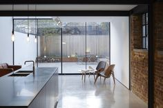 polished concrete flooring bleeds out to courtyard - Victorian workshop conversion - Clapton, London - Giles Pike House Design, House, Industrial House, Victorian Homes, Polished Concrete Kitchen, Concrete Floors, House Interior, Concrete Kitchen Floor, Interior Design