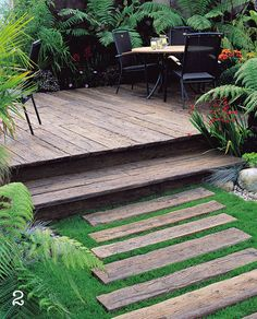 decking with step and steps in grass by Garden House Design