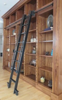 Black Metal Materials Modern Library Ladders with Low Style Tube Shaped Handrails and Double Side Space Wheel Underneath the Base Ladder Legs