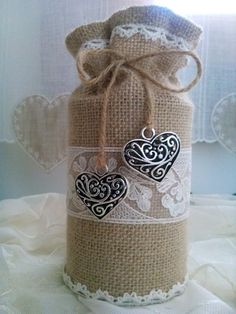Burlap sac in a rustic style with lace and heart accents. Table display…
