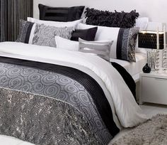 logan and mason 3 piece duvet cover black, silver grey.  LOVE IT but might be a ras too fancy with these two Bulls in my house. Just Josies butt breaks stuff when she Salma too close to something