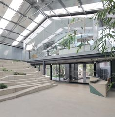 Completed in 2017 in Guangzhou, China. Images by Liky Photos. This green work-studio was transformed from the central part of a vacant plant-house built hill-side facing south that used to be a warm house for. Factory Architecture, Industrial Architecture, Architecture Office, Sustainable Architecture, Warehouse Living, Warehouse Design, Warehouse Office Space, Conception D'entrepôts, Office Designs