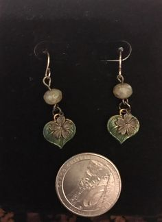 Iron Spring! Tiny metal flower and leaf charms, and ivory glass beads.  $15.00, US shipping included.  International shipping is calculated and can take up to 21 days to arrive.  Paypal is preferred.  Please message me for other payment options. Thank you! Iron Springs, Metal Flowers, 21 Days, Glass Beads, Charms, Elephant, Owl, Ivory, Drop Earrings