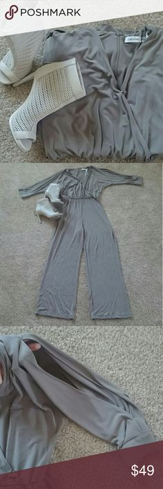 Calvin Klein jumpsuit New with no tag, split sleeve, very comfortable, elegant jumpsuit  Materials: 95% Polyester  5 % Spandex Calvin Klein Pants Jumpsuits & Rompers