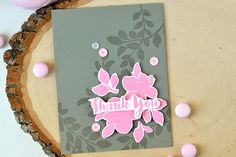 Gray card base and stamped flowers using Altenew's stamp set: Floral Shadow. The designer used Versamark ink and added few details with sequins. For more info, check out our blog. http://www.altenew.com