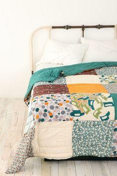 I like the simple quilts.   quilts juliacoscia  http://media-cache7.pinterest.com/upload/30328997460074477_qAYJmcuN_f.jpg