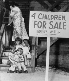 August 4, 1948 - Chicago, Illinois: They're on the auction block. These small children of Mr. and Mrs. Ray Chalifoux of Chicago, Illinois. For long months 40 year old Ray and his wife, Lucille, 24, waged a desperate but losing battle to keep food in the mouth and a roof over their heads. Now jobless and facing eviction from their near barren flat, the Chalifoux have surrendered to their heart breaking decision. Photo shows mother sobbing as the children pose wonderingly on the steps.