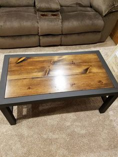 Steel and Wood coffee table with a bottom shelf . Flat black protective paint and a pine top with a dark walnut stain. These can be custom made to size! Dont be shy, send me a message with any questions