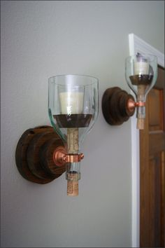 Our Rustic Finish Wood - Round Layered - Candlelight Sconce Set  We handcraft this wooden sconce set with a rustic hardwood then complete it with a rustic finish. The globes are repurposed 1.5 L wine bottles - clear with a blue tint. We remove the bottom of the bottle then polish the glass edge smooth. This sconce set is the perfect gift for anniversaries, birthdays or for yourself and look beautiful in kitchen, dining and living room areas. Handcrafted wooden products have natural…