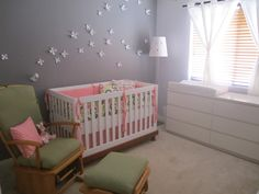 This is uber cute. Maybe we should move the changing table. I looovee the flowers on the wall too.