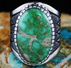 """Alton Bedonie Rare Gem Grade Carico Lake Supreme Turquoise Ring #AltonBedonie Size: 10.5 A dazzling bright Carico Lake turquoise cabochon is the highlight of this striking ring created by Alton Bedonie. The gem grade natural cabochon is a look once referred to as """"supreme"""" in the 1970s. The stone exhibits a gorgeous light shade of lime green with tan matrix and is thick cut with a wonderful dome. It sits in Alton's signature high hand chiseled bezel atop a heavy shank."""