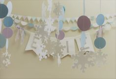 Custom paper garlands in Frozen theme colours. Perfect for parties, special occasions, and room décor. Quality cardstock in your choice of colours, patterns, shapes and sizes. Paper Garlands, Frozen Theme, Childrens Party, Bunting, Card Stock, Special Occasion, Parties, Room Decor, Colours