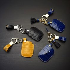 Range rover & Jaguar keycase with strap made from crocodile. #rangerover #landrover #jaguar #fashion #style #beautiful #tassels #cobaltblue #yellow #black #leatherstuff by leatherstudio.frankie