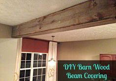 Create this easy barn wood beam covering to add some rustic chic touches to your home. Probably the easiest way to create a faux barn wood beam! False Ceiling Living Room, My Living Room, Design Hotel, House Design, Wood Ceilings, Ceiling Beams, Ceiling Lights, Reclaimed Barn Wood, Rustic Wood