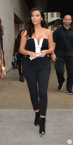 Kim Kardashian in Kardashian Kollection jumpsuit at Lipsy and Tom Ford boots