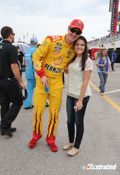 NASCAR driver Joey Logano and his fiancee Brittany Baca in the garage area at Daytona International Speedway during Speedweeks, 2014. (Photo by Jim Fluharty.)