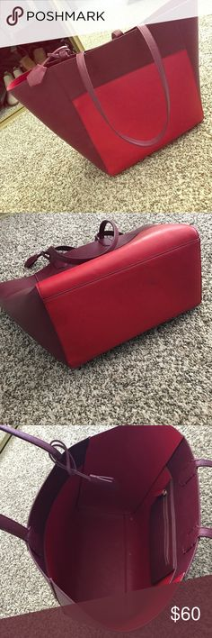 Read anthropologie tote Beautiful and vibrant red tote! Perfect condition besides small little mark on the bottom of the bag but I feel like it could probably be rubbed out. The bag opens up to about 20 inches long and about 12 inches wide. Leather material Anthropologie Bags Totes