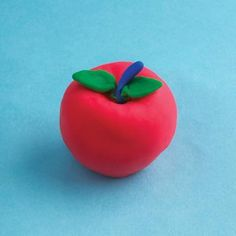Learn how to make super cool play doh creations. We love this apple for fall.
