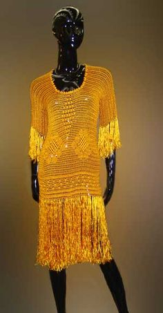 All jazzed up in a 1920s Silk Hand Crocheted Dress like Daisy Buchanan of The Great Gatsby might have worn as she zoomed across the bridge into the city.  From Lisa Victoria,