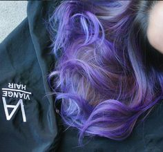 Purple hair color, curly long hairstyle.